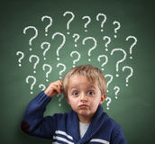 child-thinking-question-mark-blackboard-scratching-head-concept-confusion-brainstorming-choice-49028935